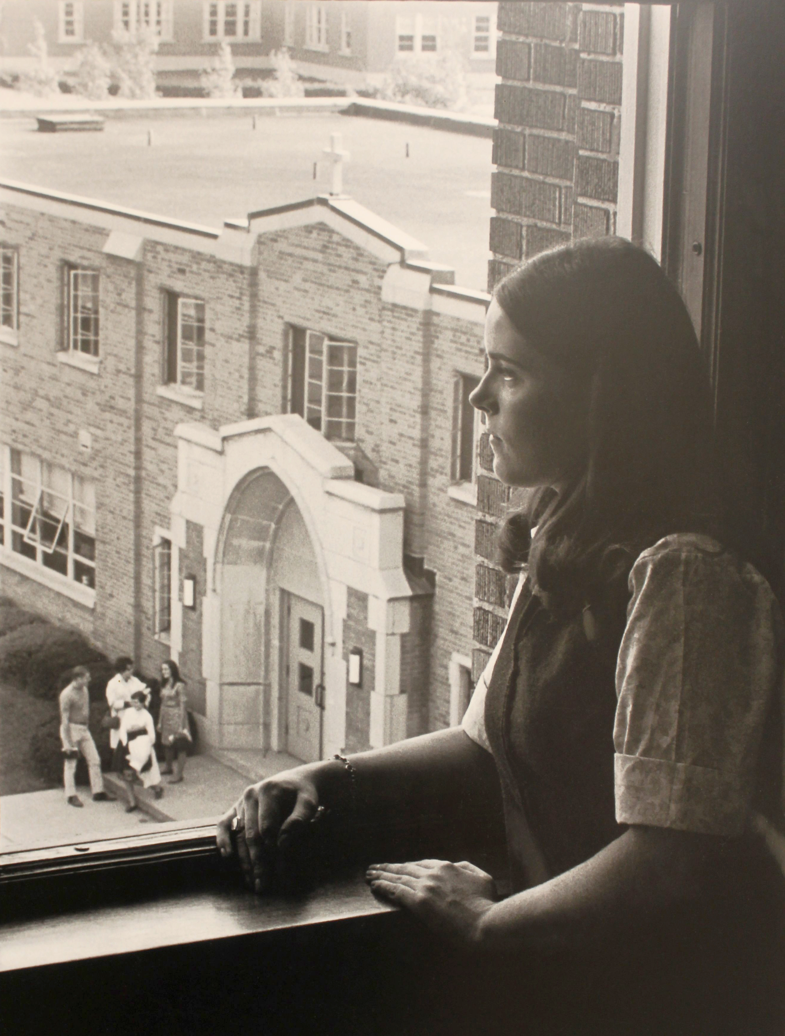 Medaille College Student Looking Out Window