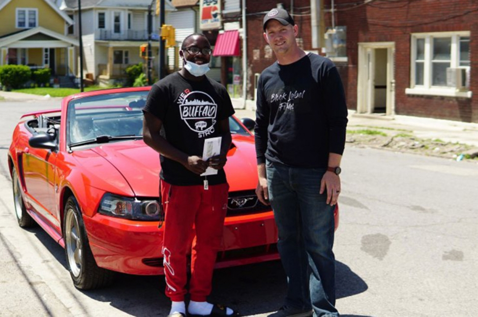 Antonio Gwynn Jr. receiving a 2004 Mustang